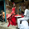 2nd prize Arts and Entertainment Singles  Vincent Boisot, France, Riva Press for Le Figaro Magazine Dakar, Senegal, 9 July A model poses in front of tailor stalls in the center of Dakar, Senegal. She wears the creation of a designer, Yolande Mancini, participating in the 9th edition of Dakar Fashion Week.