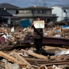 1st prize People in the News Stories Yasuyoshi Chiba, Japan, Agence France-Presse Aftermath of the tsunami, Japan, 3 April Chieko Matsukawa shows her daughter's graduation certificate as she finds it in the debris in Higashimatsushima city, Miyagi prefecture, Japan.