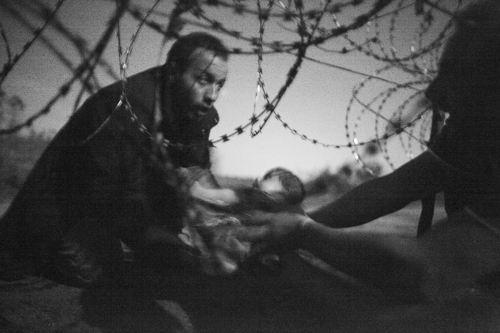 World Press Photo of the Year Warren Richardson, Australia, 2015, Hope for a New Life